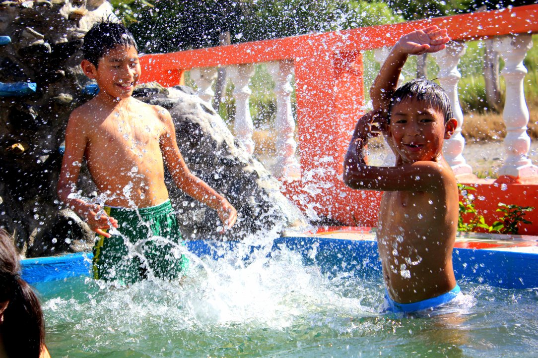 Carlos's boys enjoy the pool - Imbaburra, Ecuador