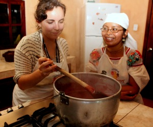 Kelsey and Tamia stirring the cooking berries