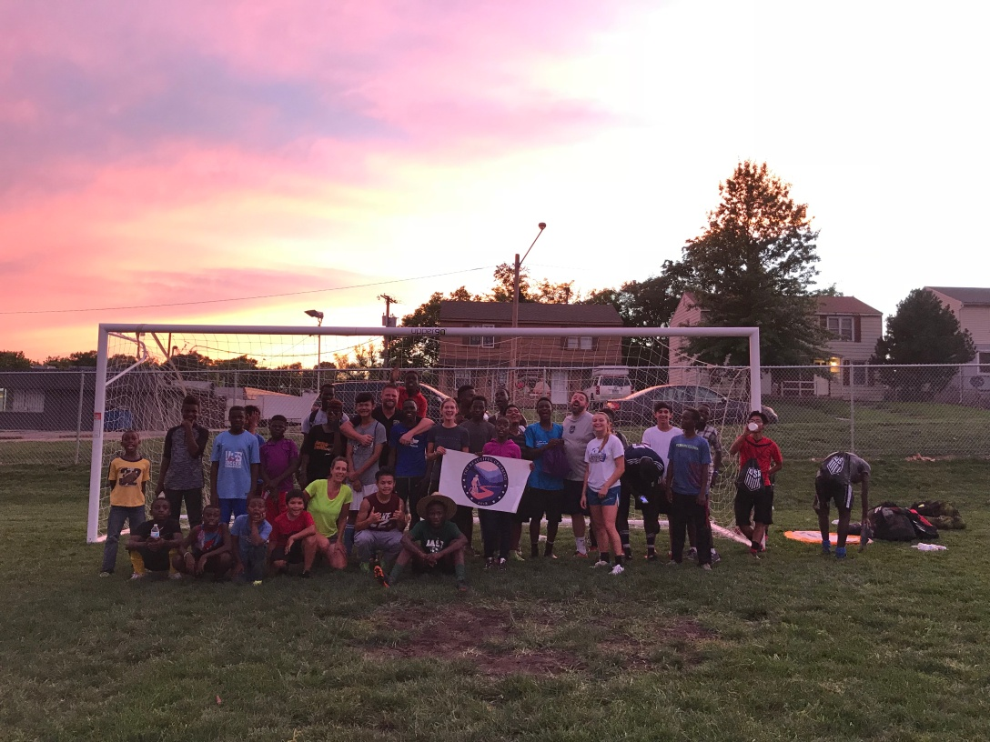 playing soccer with refugee kids in Kansas City